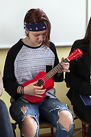 """Serbia. Vranje is a city and the administrative center of the Pčinja District in southern Serbia. «Jovan Jovanović Zmaj» Elementary School. Students during a theater performance on preventing violence and discrimination. A teenage girl with a small red guitar. The Pestalozzi Children's Foundation (Stiftung Kinderdorf Pestalozzi) is advocating access to high quality education for underprivileged children. It supports in Vranje a project called"""" Education for child rights"""".17.4.2018 © 2018 Didier Ruef for the Pestalozzi Children's Foundation"""