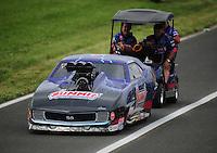Jun. 1, 2012; Englishtown, NJ, USA: Crew members push the car of NHRA pro mod driver Ken Lang during qualifying for the Supernationals at Raceway Park. Mandatory Credit: Mark J. Rebilas-