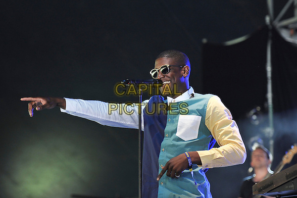 Labrinth (Timothy McKenzie) .Performs on during Day One of Wireless Festival, Hyde Park, London, England, UK, 1st July 2011..half length music live on stage concert gig sunglasses  green blue white shirt colour block hand arm microphone singing finger pointing .CAP/MAR.© Martin Harris/Capital Pictures.