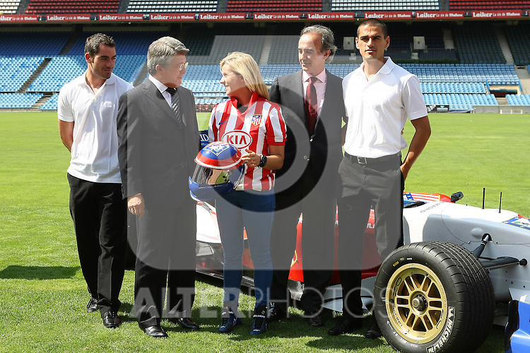 Atletico de Madrid's Superleague Formula new pilot Maria de Villota, the players Antonio Lopez and Juanito Rodriguez, the President Enrique Cerezo and the Superleague Formula's President Alex Andreu. September 01 2009. (ALTERPHOTOS/Acero).