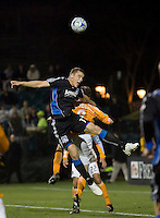 Cam Weaver (17) heads the ball over Richard Mulrooney (8). San Jose Earthquakes defeated Houston Dynamo 3-2 at Buck Shaw Stadium in Santa Clara, California on March 28th, 2009.