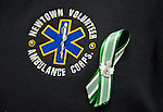 NEWTOWN, CT 19 DECEMBER- 121912JS09- EMT Jordan Reed, Treasurer/Secretary of the Newtown Volunteer Ambulance Corps in Newtown, displays a green and white ribbon on his jacket as he  talks about the situation ambulance corps first responders had to deal with last Friday at Sandy Hook Elementary School.  .Jim Shannon Republican American