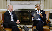 United States President Barack Obama speaks as US Vice President Joe Biden looks on while discussing the release of the Cancer Moonshot Report in the Oval Office of the White House on October 17, 2016 in Washington, DC. <br /> Credit: Olivier Douliery / Pool via CNP
