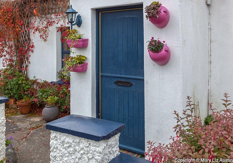 County Galway, Ireland: Irish cottage with blue door.