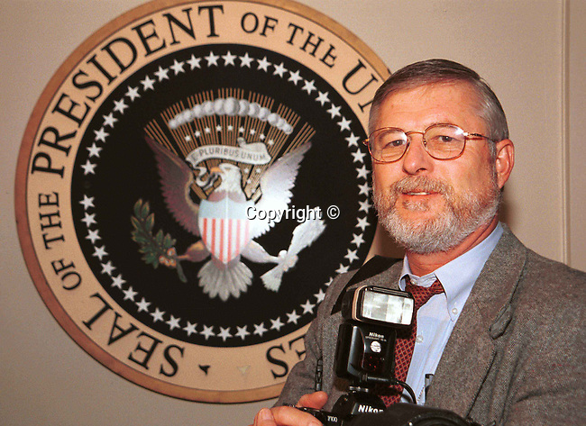 Ron Bennett with Presidential seal White House Washington DC,