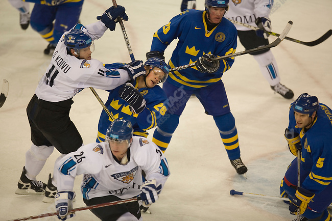 Men's Hockey final SWE wins the gold over FIN 3-2. Saku Koivu of FIN and Samuel Pahlsson of SWE in 3rd period action.