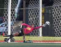 Western New York Flash goalkeeper Adrianna Franch (24) just pushes a shot wide. In a National Women's Soccer League Elite (NWSL) match, the Boston Breakers (blue) tied Western New York Flash (white), 2-2, at Dilboy Stadium on June 5, 2013.