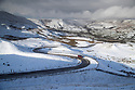 28/01/120<br /> <br /> A car makes its way up to Barber Booth from Edale in the valley below.<br /> <br /> Snow on Mam Tor, near Castleton in the Derbyshire Peak District..<br /> <br /> <br /> All Rights Reserved: F Stop Press Ltd.  <br /> +44 (0)7765 242650 www.fstoppress.com
