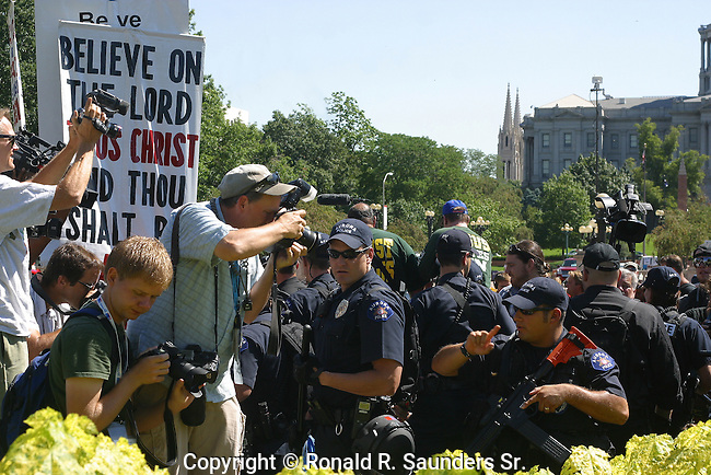 Police break up religious confrontation during the 2008 Democratic Convention. Photographers capture the moment.<br /> (2)