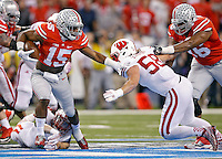 Ohio State Buckeyes running back Ezekiel Elliott (15) gets away from Wisconsin Badgers linebacker Joe Schobert (58) for a run during the 2nd quarter in the 2014 Big Ten Football Championship Game at Lucas Oil Stadium in Indianapolis, Ind. on December 6, 2014.  (Dispatch photo by Kyle Robertson)