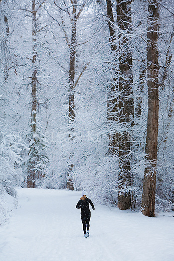 A jogger runs through the fresh snow in Greenough Park in Missoula, Montana