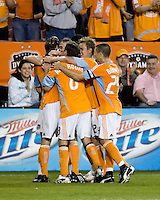 Houston Dynamo players Bobby Boswell (32), Brad Davis (11), Kei Kamara (10), Richard Mulrooney (8), Stuart Holden (22), and Wade Barrett (24) celebrate a goal.  Houston Dynamo tied Atlante FC 1-1 at Robertson Stadium in Houston, TX on February 24, 2009 in CONCACAF Champions League play .  Photo by Wendy Larsen/isiphotos.com
