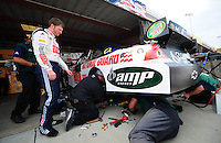 May 2, 2008; Richmond, VA, USA; NASCAR Sprint Cup Series driver Dale Earnhardt Jr looks on as crew members work on his car during practice for the Dan Lowry 400 at the Richmond International Raceway. Mandatory Credit: Mark J. Rebilas-US PRESSWIRE