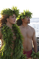 Wahine (female) and kane (male) hula dancers deep in thought, wearing palapalai fern head lei, headshot.