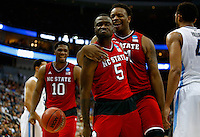 PITTSBURGH, PA - MARCH 21:  Desmond Lee #5 of the North Carolina State Wolfpack celebrates after making a shot and getting fouled with teammate Beejay Anya #21 during the second half against the Villanova Wildcats during the third round of the 2015 NCAA Men's Basketball Tournament at Consol Energy Center on March 21, 2015 in Pittsburgh, Pennsylvania.  (Photo by Jared Wickerham/Getty Images)