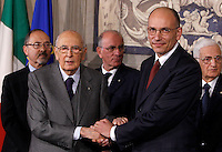 Il Presidente del Consiglio incaricato Enrico Letta stringe la mano al Capo dello Stato Giorgio Napolitano, a sinistra, dopo aver presentato la lista dei ministri del suo nuovo governo, al Quirinale, Roma, 27 aprile 2013..Italian Premier designate Enrico Letta shakes hands with the Head of State Giorgio Napolitano, left, after presenting the list of ministers of his new government, at the Quirinale presidential palace in Rome, 27 April 2013..UPDATE IMAGES PRESS/Riccardo De Luca