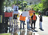 Protesters hold signs on North Kalaheo Avenue near Kailuana Place in Kailua, Hawaii as United States President Barack Obama's motorcade heads toward Marine Corps Base Hawaii. Kailua. Hawaii o Saturday, January 1, 2011..Credit: Cory Lum / Pool via CNP