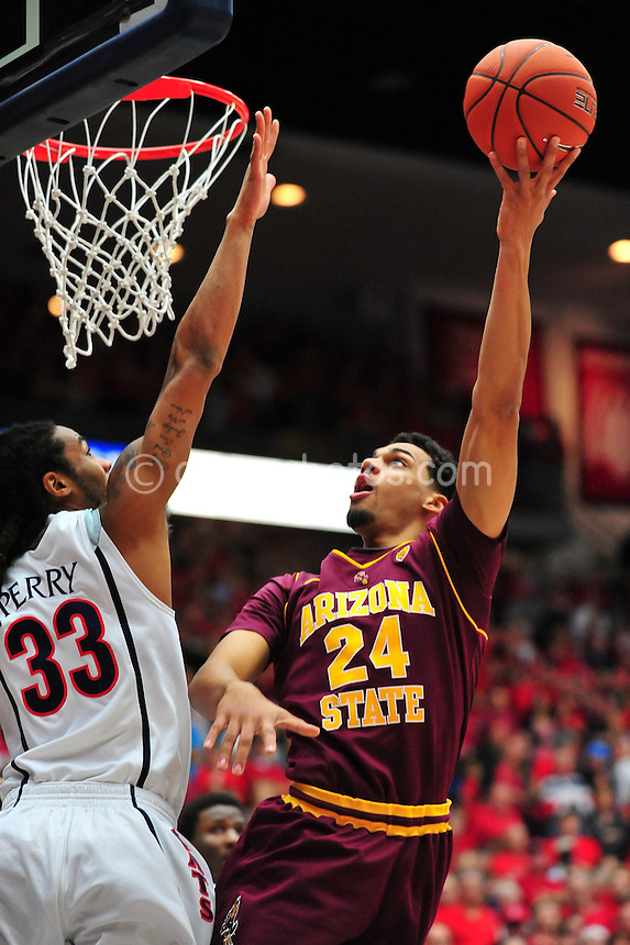 Jan 15, 2011; Tucson, AZ, USA; Arizona Wildcats forward Jesse Perry (33) tries to block the shot of Arizona State Sun Devils guard Trent Lockett (24) in the 1st half of a game at the McKale Center.  The Wildcats won the game 80-69.