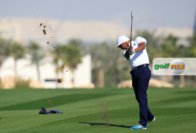 Ali Al-Shahrani (AM)(OAT) plays his 2nd shot on the 9th hole during Thursday's Round 2 of the 2015 Commercial Bank Qatar Masters held at Doha Golf Club, Doha, Qatar.: Picture Eoin Clarke, www.golffile.ie: 1/22/2015