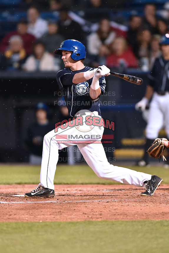 Asheville Tourists left fielder Drew Weeks (10) swings at a pitch during a game against the Greenville Drive on April 16, 2015 in Asheville, North Carolina. The Tourists defeated the Drive 5-4. (Tony Farlow/Four Seam Images)