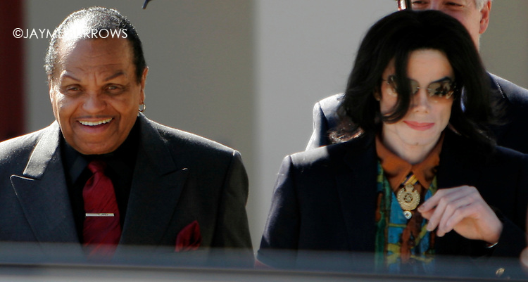 Michael Jackson leaves the courtroom after the 12th day of his child molestation trial in Santa Maria, Calif on Tuesday, March 15, 2005.  ..