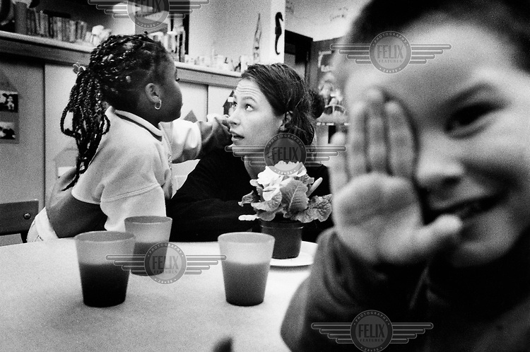 Freya van den Bossche, now Environment Minister in the Belgian government. When the picture was taken, she was a Ghent councillor responsible for education, and was on a school visit as part of her functions..