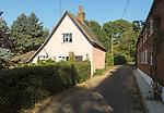 Cottages on quiet country lane in village of Shottisham, Suffolk, England, UK
