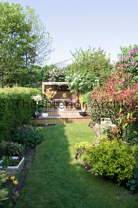 At the rear of the long garden a sun-deck has been constructed in a series of steps to make the most of any summer sun
