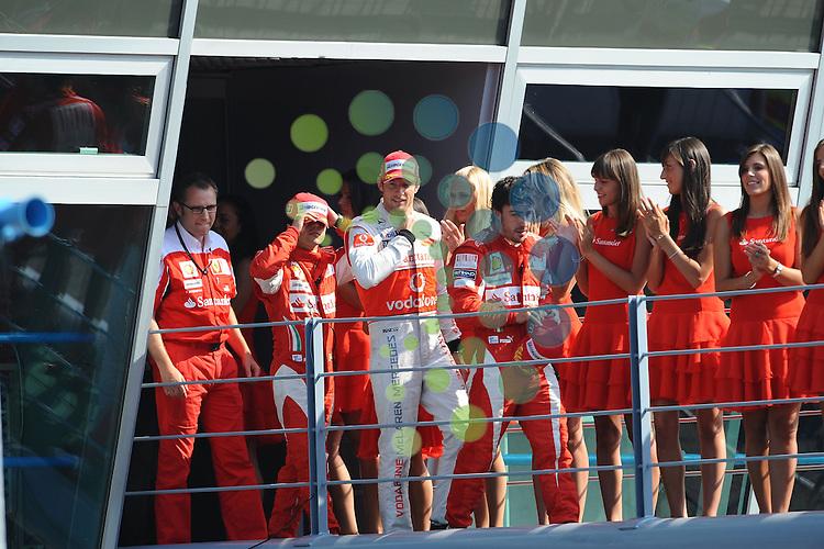 F1 GP of Italy, Monza  10.- 12. Sept. 2010.Podium - Felipe Massa (BRA), Scuderia Ferrari - Jenson Button (GBR),  McLaren F1 Team  - Fernando Alonso (ESP),  Scuderia Ferrari ..Picture:Hasan Bratic/Universal News And Sport (Europe) 12 September 2010.