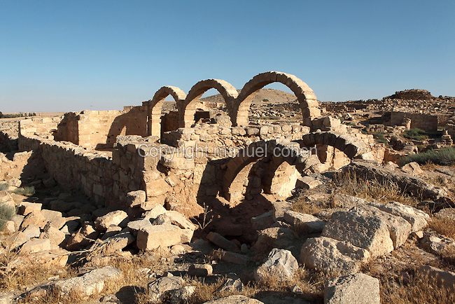 Row of arches in the Church of St Paul, Byzantine period, which is named after a graffito carved on one of its roof tiles, 'St Paul, save the Blues and Papiona of George, the lector. Amen', Umm ar-Rasas, Amman, Jordan. Umm ar-Rasas is a rectangular walled city which grew from a Roman military camp in the Jordanian desert. Its remains date from the Roman, Byzantine and Umayyad periods (3rd - 9th centuries), including 16 churches with mosaic floors. Excavations began in 1986, although most of the site remains unexplored. It was declared a UNESCO World Heritage Site in 2004. Picture by Manuel Cohen