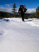 Appalachian Trail - A hiker on Low's Bald Spot during the winter months in the the White Mountains of New Hampshire. Lows Bald Spot is just off Madison Gulf Trail.