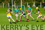 Crotta O'Neills Declan O'Donoghue on the run as Abbeydorney's Mikey Clifford and Darragh Scanlon bear down on him, in the 1st round of the North Kerry Hurling Championship.