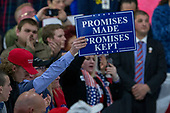 A supporter holds a campaign sign as United States President Donald J. Trump speaks during a Make America Great Again campaign rally at Atlantic Aviation in Moon Township, Pennsylvania on March 10th, 2018. Credit: Alex Edelman / CNP