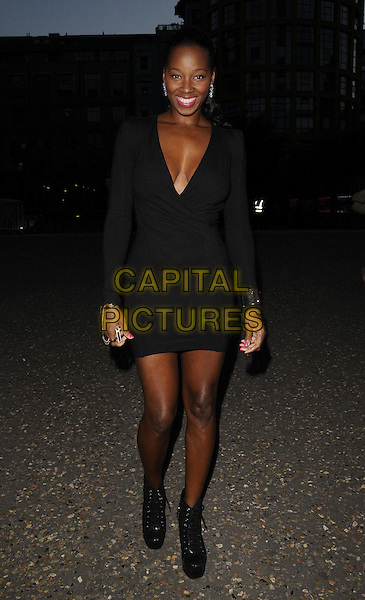 Jamelia (Jamelia Niela Davis).The Warner Music Group Olympics 2012 Party, Tate Modern Gallery, Bankside, London, England..July 26th, 2012.full length black dress plunging neckline cleavage boots .CAP/CAN.©Can Nguyen/Capital Pictures.