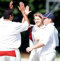 Hornsey captain Chetan Patel (L) congratulates A Murphy after he dismissed B Thakkar during the Middlesex County Cricket League Division Two game between Hornsey and Harrow Town at Tivoli Road, Crouch End on Sat Sept 3, 2011