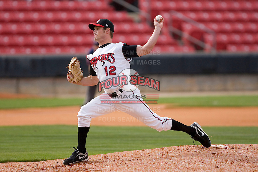 Starting pitcher Travis Wood #12 of the Carolina Mudcats in action versus the Jacksonville Suns at Five County Stadium May 18, 2009 in Zebulon, North Carolina. (Photo by Brian Westerholt / Four Seam Images)