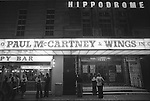 "Paul and Linda McCartney Wings Tour 1975. Fans wait outside the the Hippodrome theatre. Paul McCartney and Wings in Concert, Bristol, England The photographs from this set were taken in 1975. I was on tour with them for a children's ""Fact Book"". This book was called, The Facts about a Pop Group Featuring Wings. Introduced by Paul McCartney, published by G.Whizzard. They had recently recorded albums, Wildlife, Red Rose Speedway, Band on the Run and Venus and Mars. I believe it was the English leg of Wings Over the World tour. But as I recall they were promoting,  Band on the Run and Venus and Mars in particular."