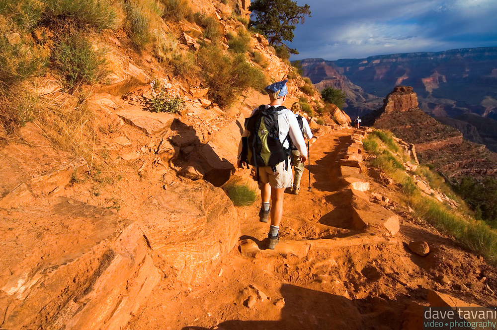 Hikers trek down the South Kaibab Trail towards O'Neill's Butte in the Grand Canyon National Park, Arizona.