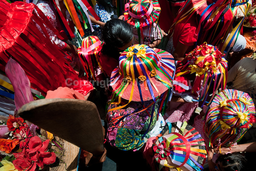 "The Negritas dancers with colorful ribbons on hats walk in the religious procession in Atanquez, Sierra Nevada, Colombia, 3 June 2010. A colorful celebration of Corpus Christi is held in the Kankuamo Indians territory every year. ""The Dance of the Devils"" is an ancient tradition kept for centuries on the Colombia's Caribbean coast. This Christian religious event usually coincides with the summer solstice, which has always been the key point for the native cultures and for the black African slaves. Due to this confluence, the Kankuamo myths, the African animistic rites and other Pre-Columbian features have blended with the Spanish Catholic festival into a lively spectacle."