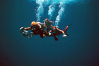 .3 scuba divers in the deep ocean. MR