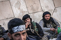 In this Friday, Sep. 20, 2013 photo, salafists fighters sit as they expect for a Syrian army retaliation in the Kafr Nabudah village where opposition fighters clash with troops loyal to president Bashar Al-Assad as they have launched an offensive for the control of the region in the Idlib province countryside, Syria. (Photo/AP).