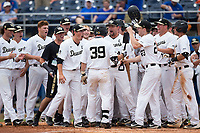 Ben Breazeale (39) of the Wake Forest Demon Deacons touches home plate as he teammates celebrate his 2-run game winning in the completion of Game Two of the Gainesville Super Regional of the 2017 College World Series at Alfred McKethan Stadium at Perry Field on June 12, 2017 in Gainesville, Florida.  The Demon Deacons walked off the Gators 8-6 in 11 innings. (Brian Westerholt/Four Seam Images)