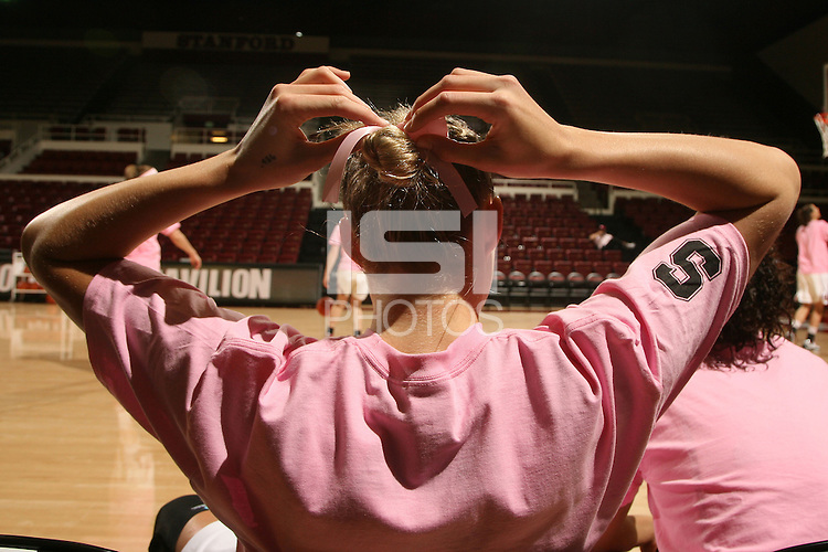 STANFORD, CA - FEBRUARY 14:  Forward Jayne Appel #2 of the Stanford Cardinal adjusts her pink ribbon during Stanford's 58-41 win against the California Golden Bears on February 14, 2009 at Maples Pavilion in Stanford, California.