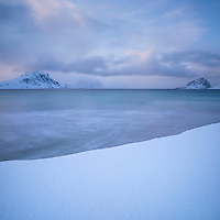 Sea meets snow at Haukland beach in Winter, Vestvågøy, Lofoten Islands, Norway