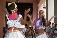 Women dancing in the streets to the Cuban band Los 4 Vientos, Havana, Cuba.