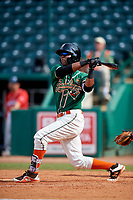 Greensboro Grasshoppers shortstop Marcos Rivera (11) follows through on a swing during a game against the Lakewood BlueClaws on June 10, 2018 at First National Bank Field in Greensboro, North Carolina.  Lakewood defeated Greensboro 2-0.  (Mike Janes/Four Seam Images)