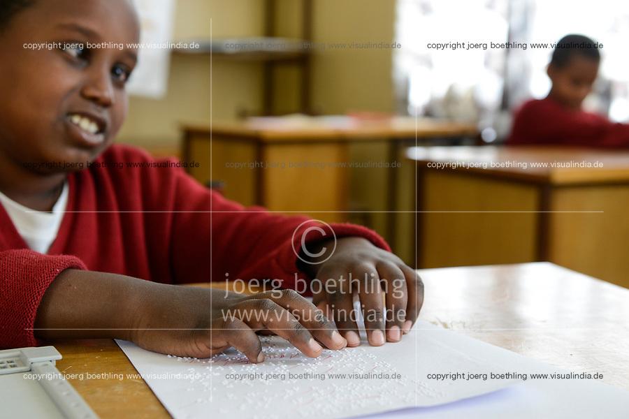ETHIOPIA, Amhara, Gondar, school for blind children, reading braille letters / AETHIOPIEN, Amhara, Gonder, Schule fuer blinde Kinder, Blindenschrift lesen, blinder Junge Smegnew Tigist, 12 Jahre