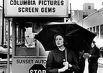 Actress Ingrid Bergman walks in rain outside Columbia Pictures screen gems won three Academy Awards two Emmy Awards and the Tony Award for Best Actress She is ranked as the fourth greatest female star of American cinema of all time by American Film Institute and best remembered for role as Lisa Lund in Casablanca with Humphrey Bogart,