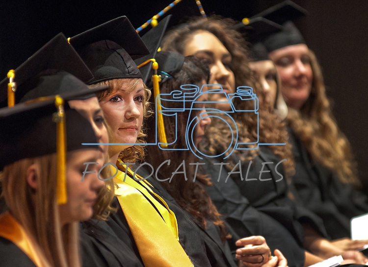 Brittany Esposito sits with fellow students at the Western Nevada College commencement in Fallon, Nev., on Tuesday, May 20, 2014. <br /> Photo by Kim Lamb