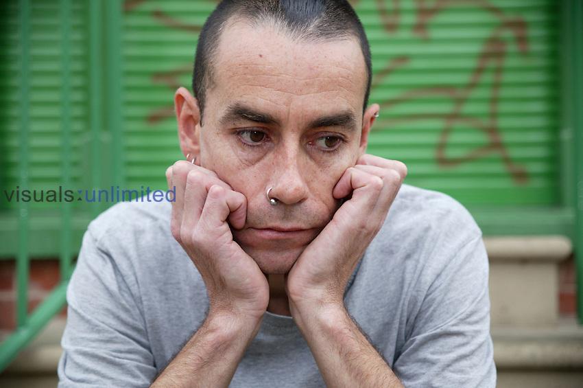 Portrait of man looking depressed. MR